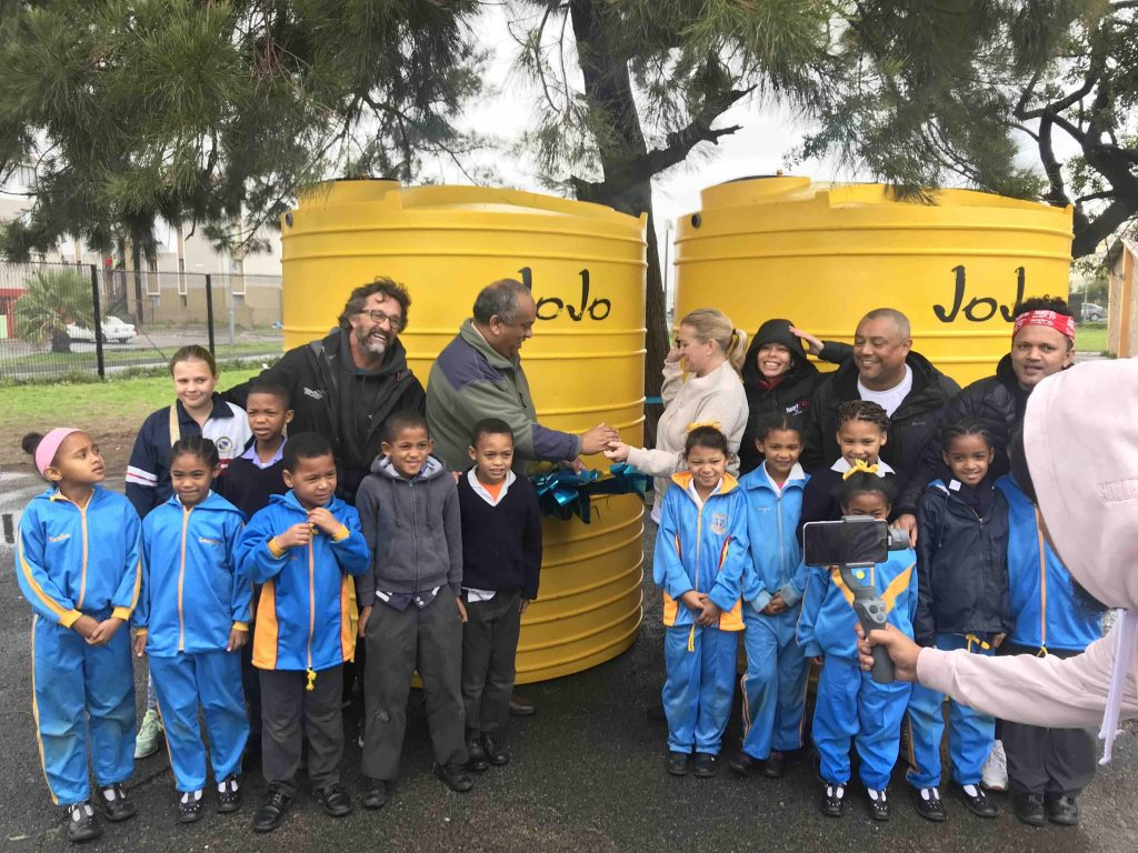 two jojo tanks with volunteers and children
