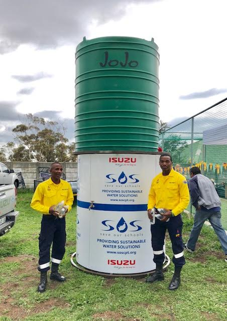 SOS Water Tank with two male African volunteers