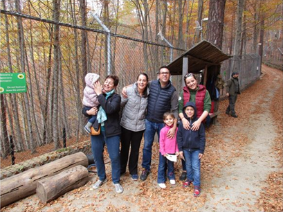 Family photo at Dancing Bear park in Bulgaria
